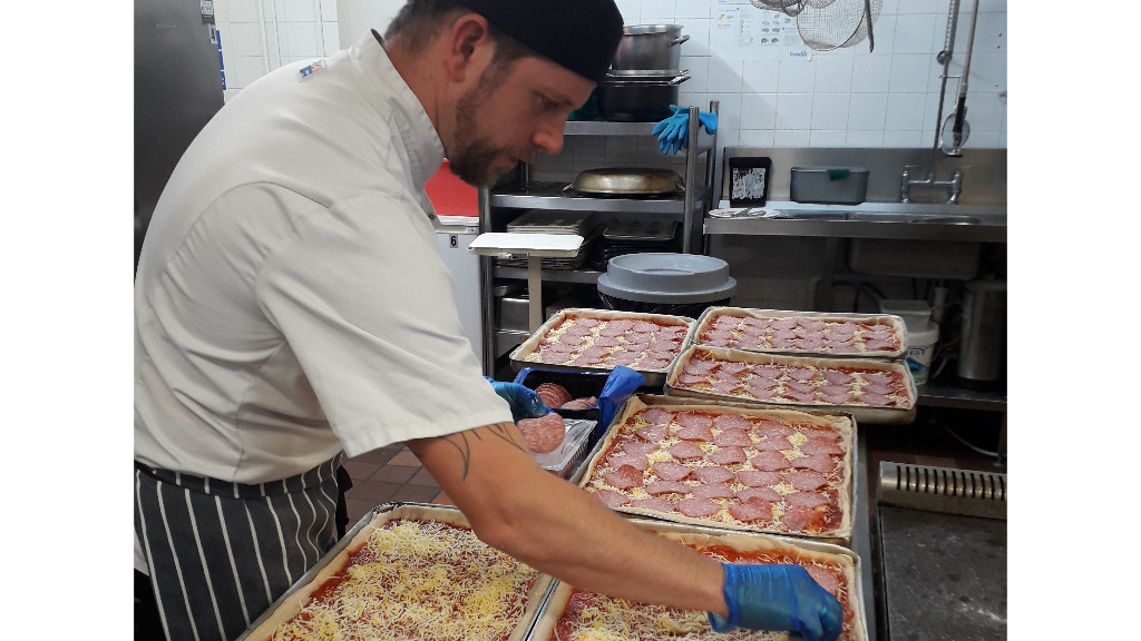 Richard, one of Hope Catering Chef's making Pizza to be delivered to Hope HandUp service and also to feed the homeless who were sheltering in the hotels
